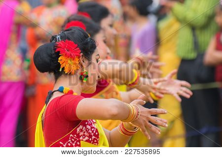 Young Girls Dancing At Holi / Spring Festival.