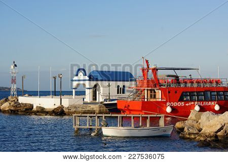 FALIRAKI, RHODES ISLAND, GREECE - OCTOBER 8, 2017: Tour boat in the port of Faliraki. Faliraki is a popular tourist destination with a 5 km stretch of sand and 12 FEE Blue Flags