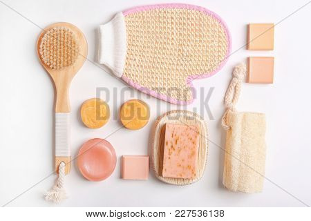 Flat lay composition with bath accessories on white background