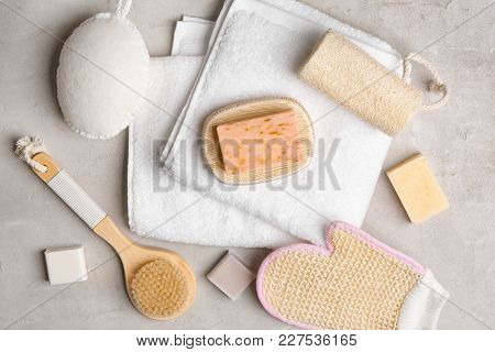 Soft towel and bath accessories on table