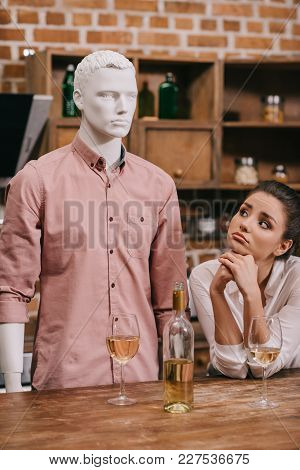 Portrait Of Sad Woman Looking At Manikin Near By At Home, Perfect Relationship Dream Concept