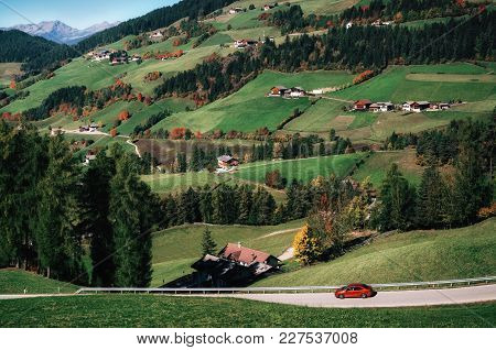 Adventure Trip By Car On Mountain Road Against Alpine Green Meadows In Italian Dolomites Alps, Funes