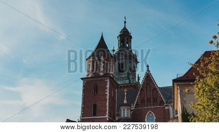 Domes of two Renaissance chapels on the side of the cathedral on Wawel Hill in Krakow Poland. Poland's monarchs used to be crowned here. The chapel with the golden dome is Kaplica Zygmuntowska poster
