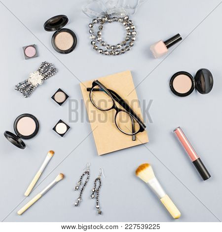 Woman Fashion Accessories, Jewelry And Make Up Products On Stylish Gray Background. Flat Lay, Top Vi