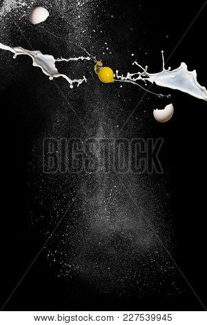 Cook Breakfast. Egg In Flight, Milk And Flour On Black Background. Scattering Egg Shells. Free Space
