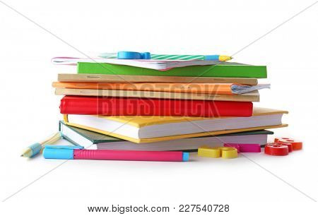Stack of notebooks and books on white background. Doing homework