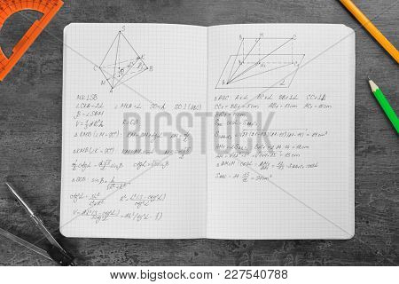 Exercise book with homework on table