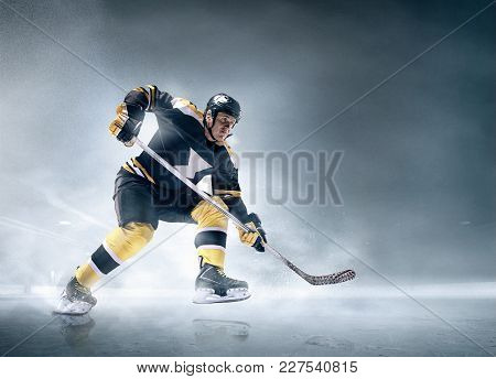Decisive Throw Of The Puck And Goal. Ice Hockey Player In Action On Ice. Male Professional Athlete S