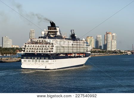 The View Of A Cruise Liner Leaving Miami City At Dusk With Miami Beach Skyline In A Background (flor