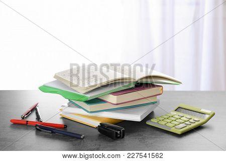 Pile of homework on table