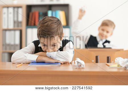Bullied little boy in classroom