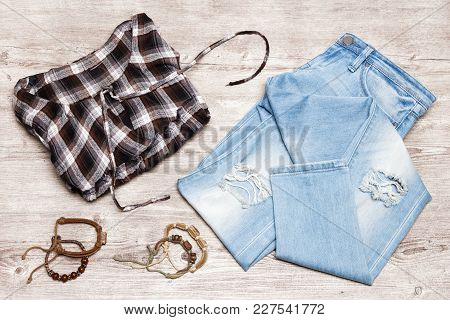Hippie Fashion Style Women Outfit. Cotton Check Shirt, Ripped Jeans, Rope Wood Bead Bracelets On Sha