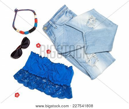 Fashion Summer Women Outfit. Ripped Skinny Jeans, Bandeau Top, Necklace And Sunglasses On White Back