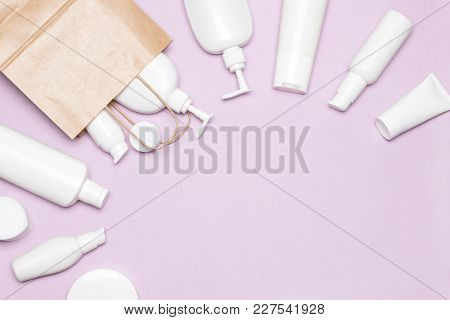Cosmetic Products With Paper Packaging Bag. Beauty Shopping Concept, Copy Space