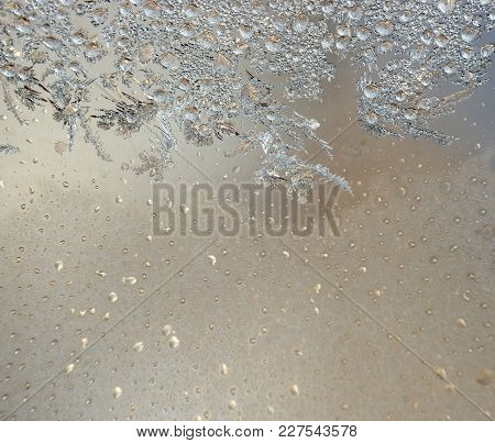 Colorful Background With Silver Frost On Window. Frozen Water On The Window Creates Silver Beautiful