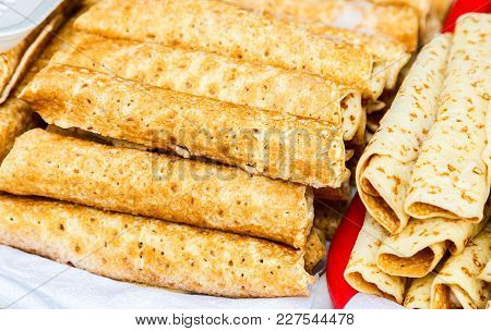 Russian Traditional Food. Appetizing Fried Pancakes On The Pancake Week