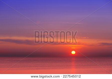 Eautiful Red-purple Sunset At Sea. Evening Calm