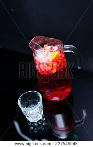 Red Wine Sangria Or Punch With Fruits And Ice In Glasses And Pincher. Homemade Refreshing Fruit Sang