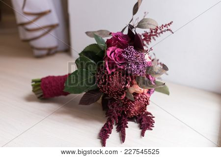 Delicate, Expensive, Trendy Bridal Wedding Bouquet Of Flowers In Marsala And Red Color. Wedding Acce