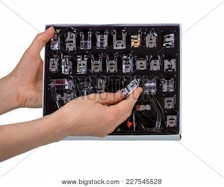Set Of Presser Feet To Sewing Machine Isolated On White Background