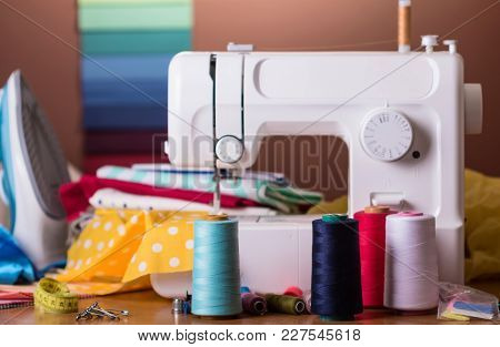 Modern Sewing Machine, Spool With Fiber, Sewing Accessories And Iron
