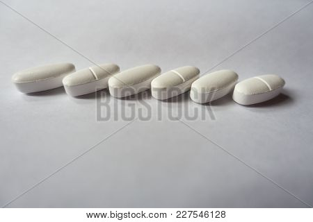 Oval Pills Of Calcium Citrate In A Row