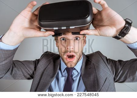 Young Surprised Businessman With Virtual Reality Headset