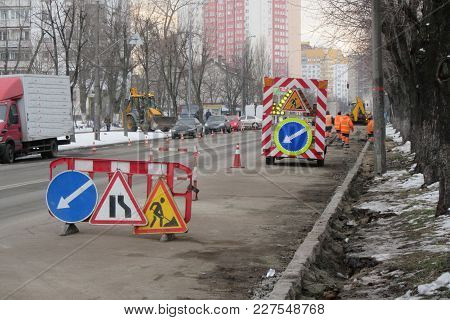 Traffic Safety Roadwork Signs On The City Street. Roadworks Begin On Street. Road Services  Cones An