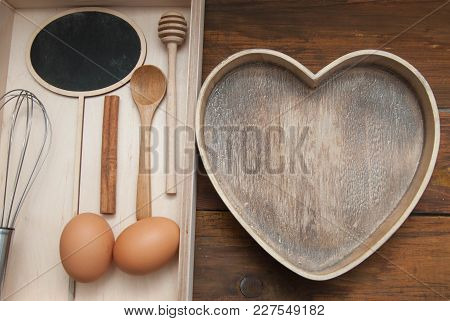Flat Lay Of Food Process Background. Raw Eggs With Wooden Spooon And Baking Tools. Bake Or Food Back