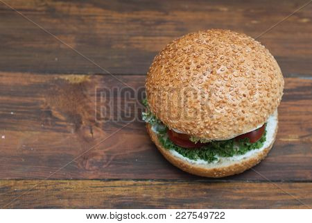 Top View Of Homemade Hamburger With Fresh Letuce Leaves, Tomatoe Slice, Meat. Homemade Healthy Food