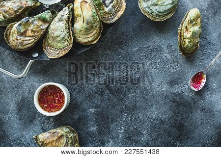 Fresh Oysters Platter With Sauce And Ice With Copy Space On Dark Background. Flat Lay/ Top View