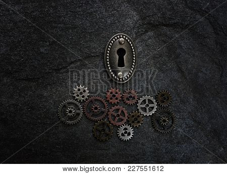 Assorted Gears With A Vintage Lock On Textured Surface