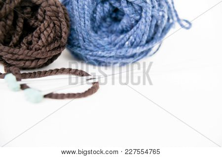 Knitting Yarn And Knitting Needles On A Table