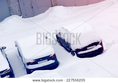 Cars In The Parking Lot In The Snow