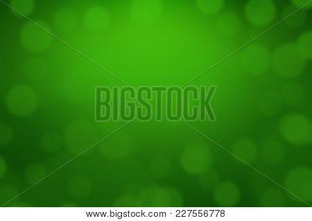 Green Bokeh Lights Defocused For Design Patrick's Day Background