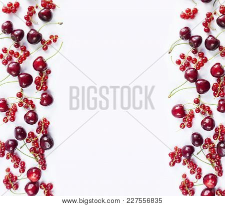 Red Fruits And Berrieson White Background. Ripe Red Currants And Cherries. Berries At Border Of Imag