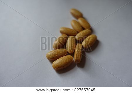 Orange Pills Of Multivitamin Complex Dietary Supplement