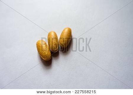 Oblong Orange Tablets Of Multivitamins (three Items)