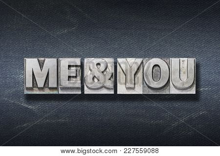 Me & You Phrase Made From Metallic Letterpress On Dark Jeans Background