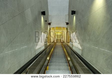 Empty Escalator And Stairs Going Down In Subway At Railway Station, Airport, Office Building Or Depa