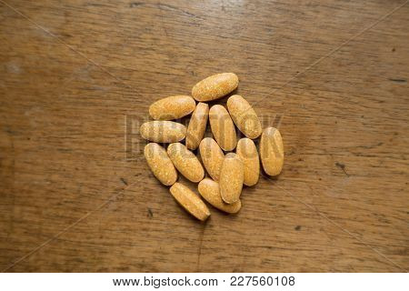 Multivitamin Tablets On Wooden Table From Above