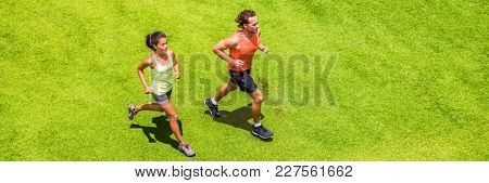 Runners running people couple fitness banner. Healthy active lifestyle. Active couple jogging together on grass park view from above. Summer weight loss training program.