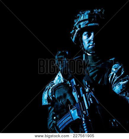 Us Marine Corps Soldier Under Cover Of Darkness. Dark Gloomy Night