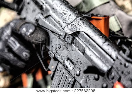Close-up Shot Of Kalashnikov Rifle Automatic Weapons In Hands Of Army Special Forces Soldier Under T
