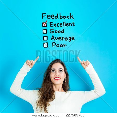 Feedback With Young Woman Reaching And Looking Upwards