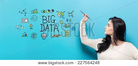 Big Data With Young Woman Holding A Pen On A Blue Background