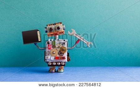 Robot Handyman Memory Flash Card Hand Wrench. Fixing Maintenance Concept. Creative Design Toy, Cogs