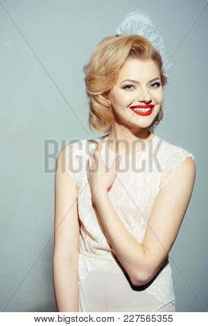 Sensual Blond Girl With Elegant Makeup, Pinup. Beauty, Fashion, Cosmetics, Vintage Style. Retro Woma