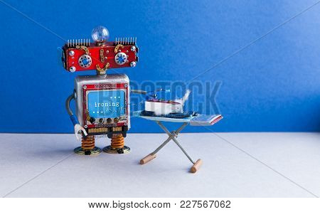 Robotic Housework Assistant Ironing Blue Jeans With Iron On The Board. Blue Wall Gray Floor Room Int
