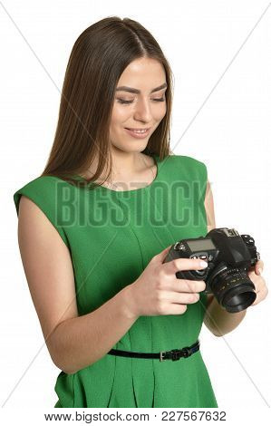 Young Beautiful Woman With Camera Over White Background